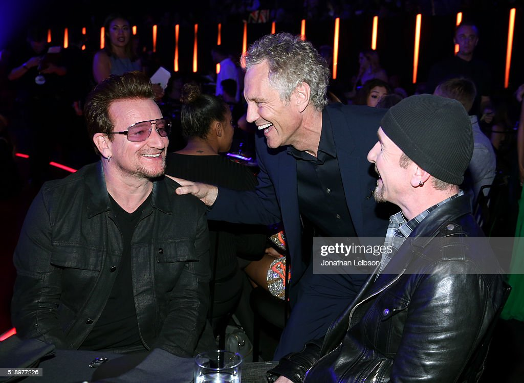 Singersongwriter Bono iHeartMedia's President of Entertainment Enterprises John Sykes and singersongwriter The Edge attend the iHeartRadio Music...