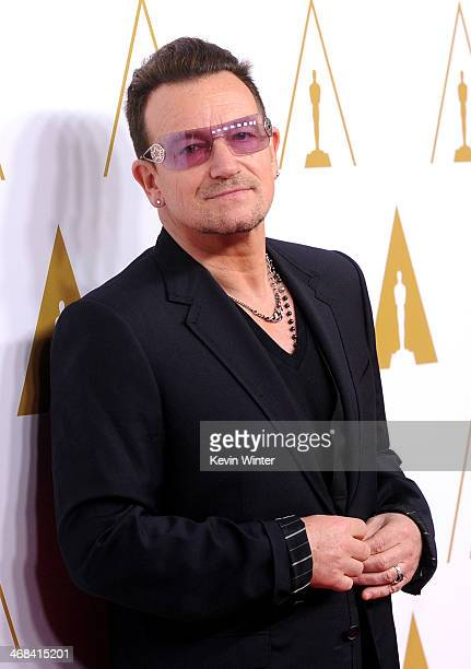 Singer/songwriter Bono of music group U2 attends the 86th Academy Awards nominee luncheon at The Beverly Hilton Hotel on February 10 2014 in Beverly...