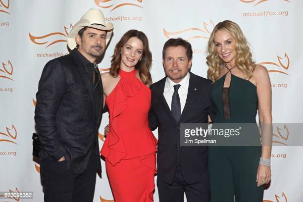 Singer/songwriter Brad Paisley actors Kimberly WilliamsPaisley Michael J Fox and Tracy Pollan attend the 2017 A Funny Thing Happened on the Way to...