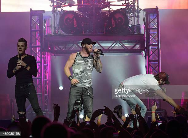 Singer/Songwriter Brantley Gilbert is joined on stage by Chase Bryant and Brian Davis during his 'Let it Ride Tour' stop at Bridgestone Arena on...