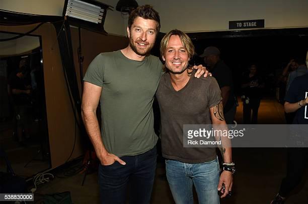 Singer/songwriter Brett Eldredge and singer/songwriter Keith Urban attend the 2016 CMT Music awards at the Bridgestone Arena on June 8 2016 in...