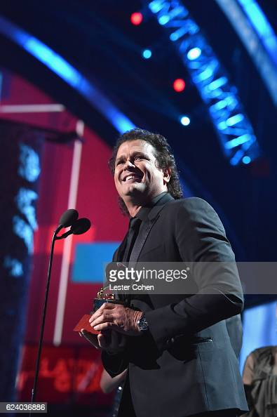 Singer/songwriter Carlos Vives accepts Record of the Year for 'La Bicicleta' onstage during The 17th Annual Latin Grammy Awards at TMobile Arena on...