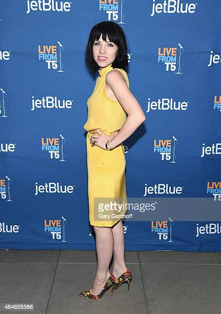 Singer/songwriter Carly Rae Jepsen poses for pictures after performing live during JetBlue's Live From T5 Concert With Carly Rae Jepsen at John F...