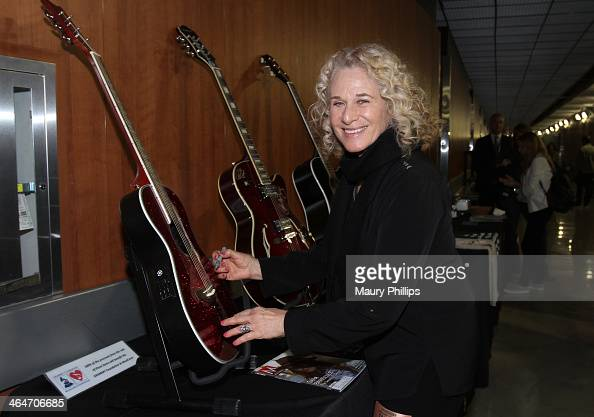 Singer/songwriter Carole King poses backstage with the GRAMMY Charities Signings during the 56th GRAMMY Awards at Staples Center on January 23 2014...