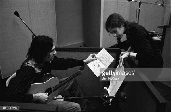 Singersongwriter Carole King showing James Taylor through chord charts during the recording of her album 'Tapestry' at AM Records Recording Studio in...