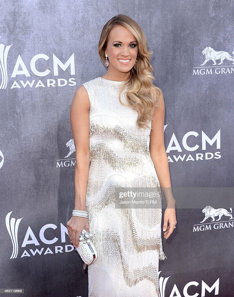 Singer/songwriter <a gi-track='captionPersonalityLinkClicked' href=/galleries/search?phrase=Carrie+Underwood&family=editorial&specificpeople=204483 ng-click='$event.stopPropagation()'>Carrie Underwood</a> attends the 49th Annual Academy Of Country Music Awards at the MGM Grand Garden Arena on April 6, 2014 in Las Vegas, Nevada.