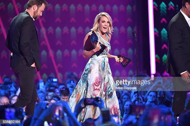 Singersongwriter Carrie Underwood onstage during the 2016 CMT Music awards at the Bridgestone Arena on June 8 2016 in Nashville Tennessee
