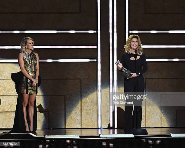 Singersongwriter Carrie Underwood presents an award to Shania Twain on stage during CMT Artists of the Year 2016 on October 19 2016 in Nashville...