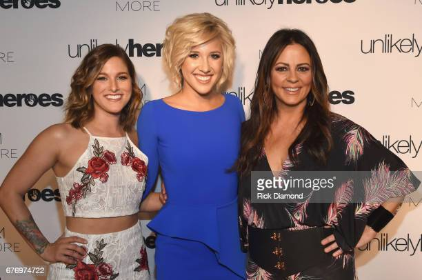 Singersongwriter Cassadee Pope actress Savannah Chrisley and singersongwriter Sara Evans take photos on carpet for Unlikely Heroes hosts Night of...