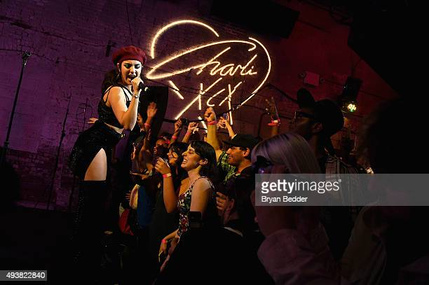 Singersongwriter Charli XCX performs onstage during the Boohoocom fete celebrating the Charli XCX collaboration at Villian on October 22 2015 in...