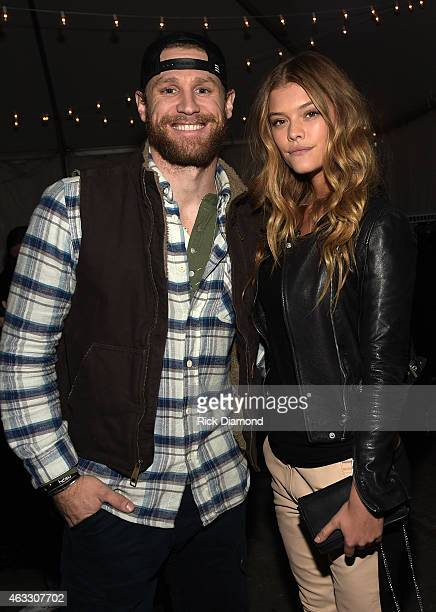 Singer/Songwriter Chase Rice and SI Swimsuit Model Nina Agdal attend the 2015 Sports Illustrated Swimsuit's 'Swimville' Takes Over Nashville Day 2 on...