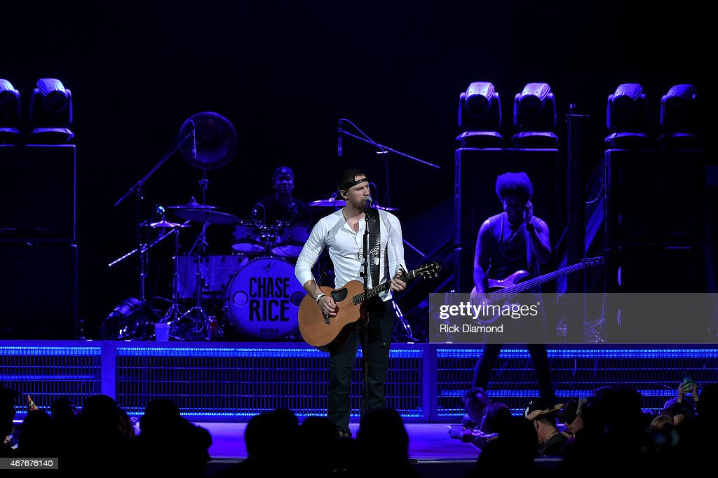 Singer-songwriter Chase Rice performs onstage during Kenny Chesney's The Big Revival 2015 Tour kick-off for a 55 show run through August. The high-energy opening night included 2 ½ hours of music, including five songs from his #1 The Big Revival, surprise guests, a leaner, cleaner stage and 2.3 million pixel screen that gave the sold out house the best view theyve ever had of the 8-time Entertainer of the Year at the Bridgestone Arena on March 26, 2015 in Nashville, Tennessee