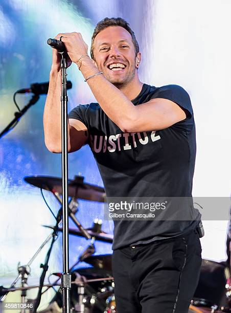 Singersongwriter Chris Martin of the band Coldplay is seen performing with U2 during a Surprise World AIDS Day concert at Times Square on December 1...
