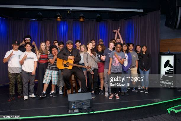 Singer/Songwriter Chris Pierce poses with the students at The Grammy Museum's Educational Intiative Backstage Pass Acoustic Performance And QA at The...