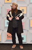 Singersongwriter Chris Stapleton winner of the Male Vocalist of the Year New Male Vocalist of the Year and Album of the Year awards poses in the...