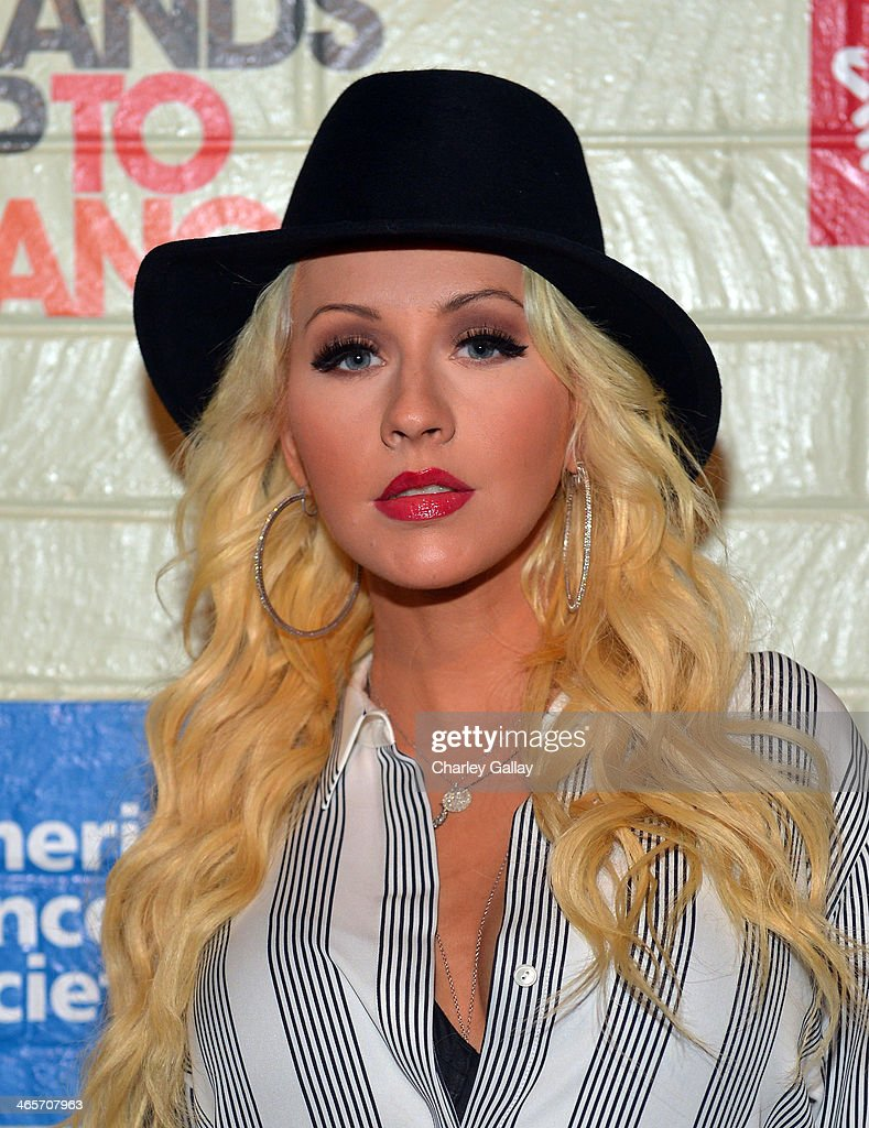 Singer/songwriter <a gi-track='captionPersonalityLinkClicked' href=/galleries/search?phrase=Christina+Aguilera&family=editorial&specificpeople=171272 ng-click='$event.stopPropagation()'>Christina Aguilera</a> attends Hollywood Stands Up To Cancer Event with contributors American Cancer Society and Bristol Myers Squibb hosted by Jim Toth and Reese Witherspoon and the Entertainment Industry Foundation on Tuesday, January 28, 2014 in Culver City, California.