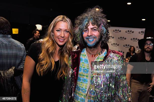 Singer/songwriter Colbie Caillat and musician Wayne Coyne of The Flaming Lips backstage at the Amnesty International Concert presented by the CBGB...