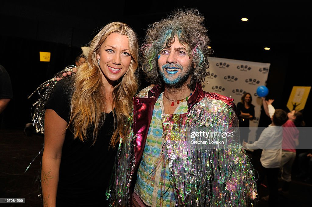 Singer/songwriter Colbie Caillat (L) and musician Wayne Coyne of The Flaming Lips backstage at the Amnesty International Concert presented by the CBGB Festival at Barclays Center on February 5, 2014 in New York City