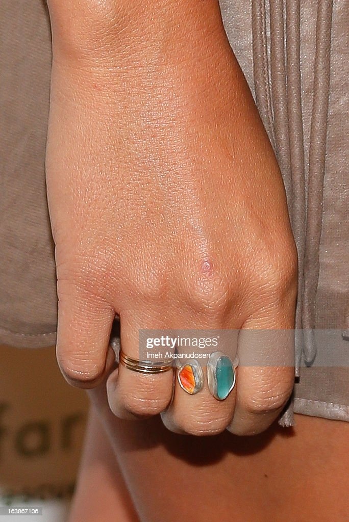 Singer/songwriter Colbie Caillat (ring detail) attends the Fun For Animals Celebrity Poker Tournament & Cocktail Party at Petersen Automotive Museum on March 16, 2013 in Los Angeles, California.