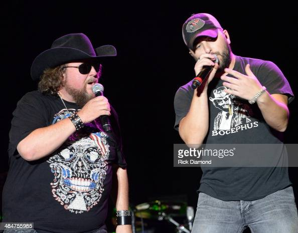Singer/Songwriter Colt Ford is joined on stage by Tyler Farr at Country Thunder USA In Florence Arizona Day 4 on April 13 2014