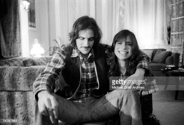 Singer/songwriter couple Carly Simon and James Taylor pose for a portrait session at the their home on October 13 1971 in New York City New York