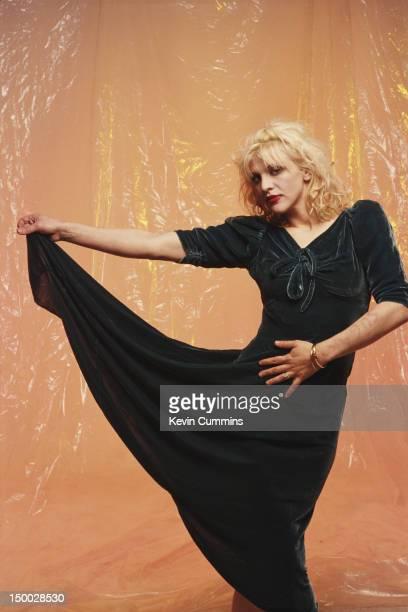 Singersongwriter Courtney Love of American alternative rock group Hole posing in a velvet dress March 1993