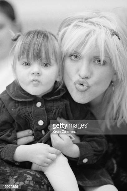 Singersongwriter Courtney Love of American alternative rock group Hole backstage with her daughter Frances Bean Cobain before a concert at Rote...
