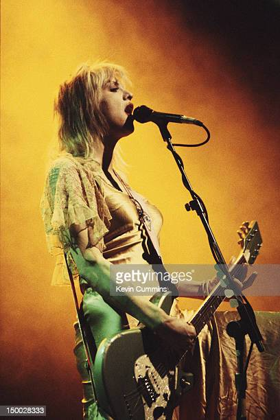Singersongwriter Courtney Love performing on stage with American alternative rock group Hole circa 1995