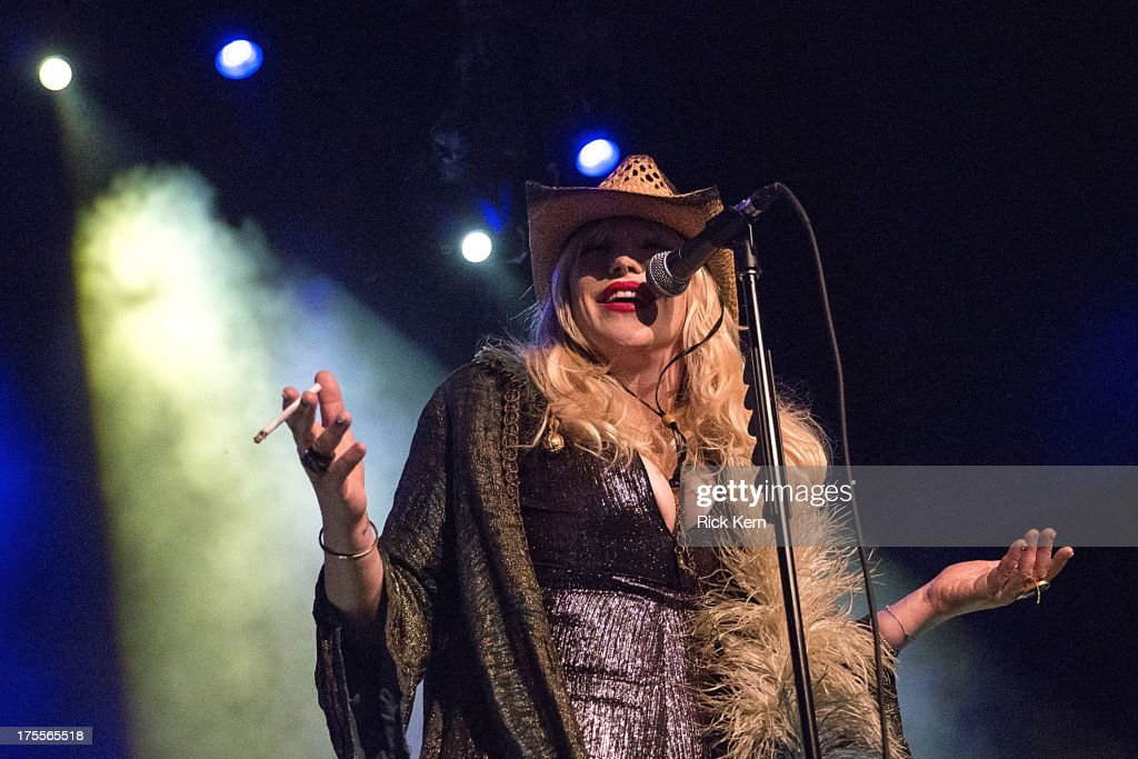 Singer-songwriter <a gi-track='captionPersonalityLinkClicked' href=/galleries/search?phrase=Courtney+Love&family=editorial&specificpeople=156418 ng-click='$event.stopPropagation()'>Courtney Love</a> performs in concert at Emo's on August 3, 2013 in Austin, Texas.