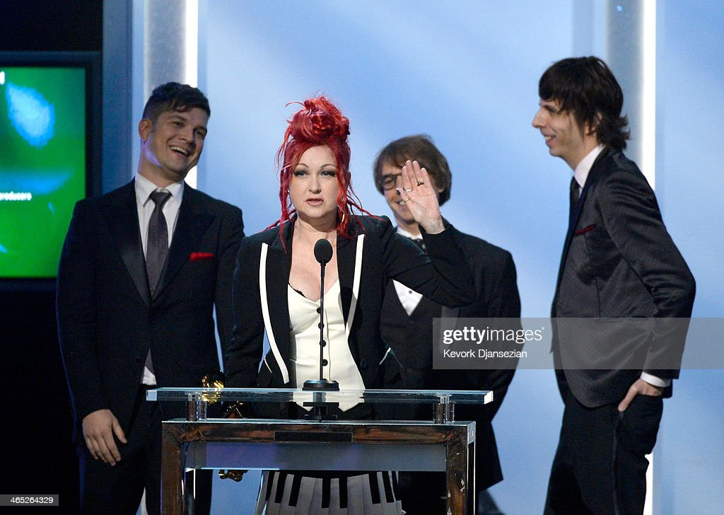 Singer/songwriter Cyndi Lauper (at podium) accepts the Best Musical Theater Album award for 'Kinky Boots' onstage during the 56th GRAMMY Awards Pre-Telecast Show at Nokia Theatre L.A. Live on January 26, 2014 in Los Angeles, California.