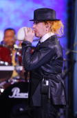 Singer/songwriter Cyndi Lauper blows up a balloon on ABC's 'Good Morning America' at ABC Studios on June 23 2010 in New York City