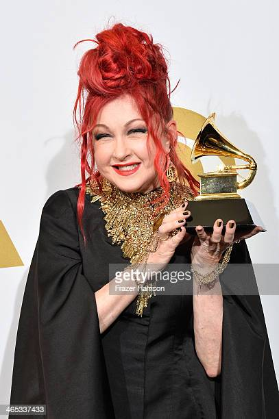 Singer/songwriter Cyndi Lauper winner of the Best Musical Theater Album award for 'Kinky Boots' poses in the press room during the 56th GRAMMY Awards...