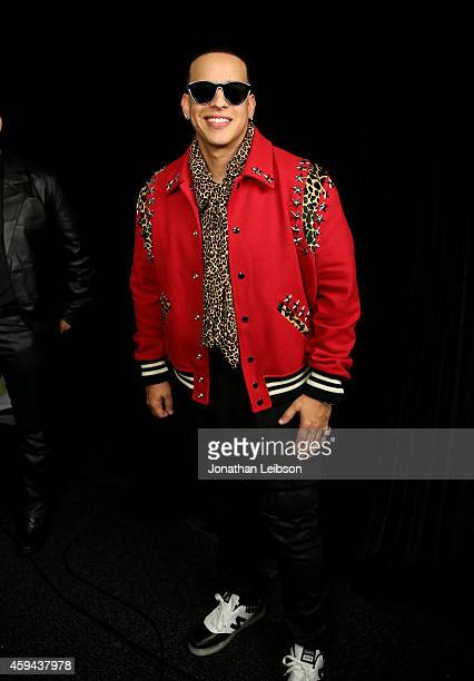 Singersongwriter Daddy Yankee poses backstage during the iHeartRadio Fiesta Latina festival presented by Sprint at The Forum on November 22 2014 in...