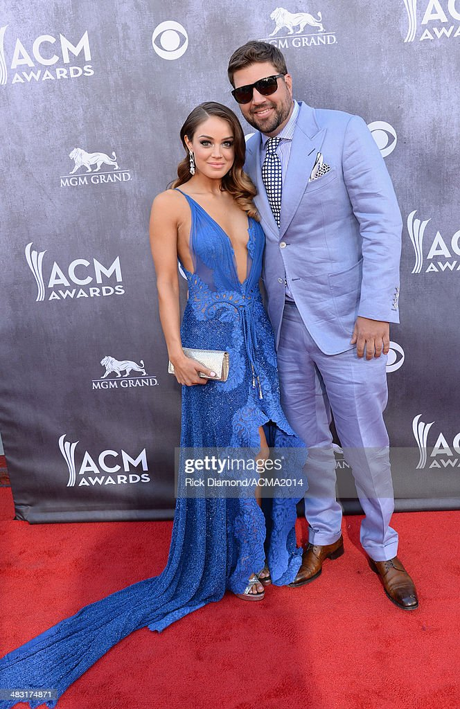 Singer/songwriter Dallas Davidson (R) and Natalia Starzynski attend the 49th Annual Academy of Country Music Awards at the MGM Grand Garden Arena on April 6, 2014 in Las Vegas, Nevada.