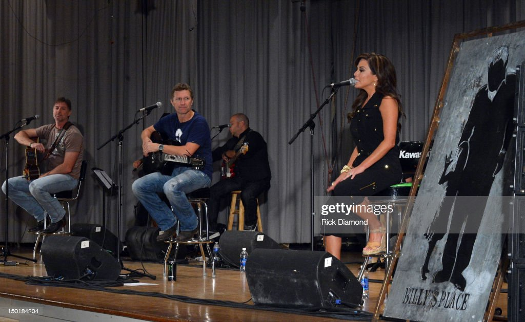 Singer/Songwriter <a gi-track='captionPersonalityLinkClicked' href=/galleries/search?phrase=Darryl+Worley&family=editorial&specificpeople=2376424 ng-click='$event.stopPropagation()'>Darryl Worley</a>, Host/Singer/Songwriter <a gi-track='captionPersonalityLinkClicked' href=/galleries/search?phrase=Craig+Morgan&family=editorial&specificpeople=238953 ng-click='$event.stopPropagation()'>Craig Morgan</a> and CNN-HLN Newswomen/Singer/Songwriter Robin Meade perform during the <a gi-track='captionPersonalityLinkClicked' href=/galleries/search?phrase=Craig+Morgan&family=editorial&specificpeople=238953 ng-click='$event.stopPropagation()'>Craig Morgan</a> 6th annual charity concert at Dickson Middle School on August 11, 2012 in Dickson, Tennessee.