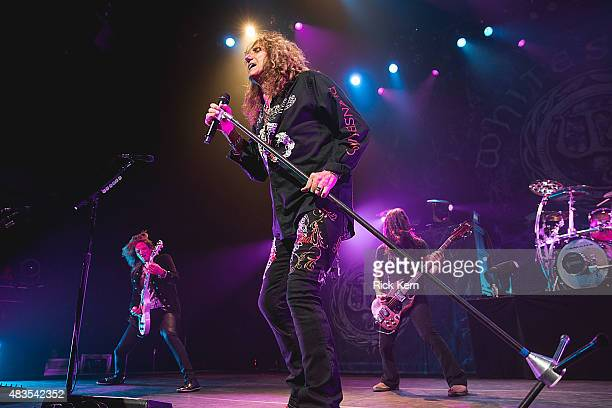 Singersongwriter David Coverdale and musicians Joel Hoekstra and Michael Devin of Whitesnake perform in concert at ACL Live on August 9 2015 in...