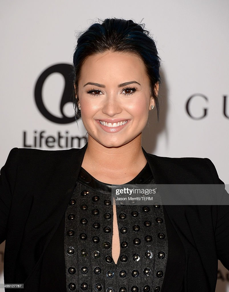 Singer/songwriter Demi Lovato arrives at The Hollywood Reporter's 22nd Annual Women In Entertainment Breakfast at Beverly Hills Hotel on December 11, 2013 in Beverly Hills, California.