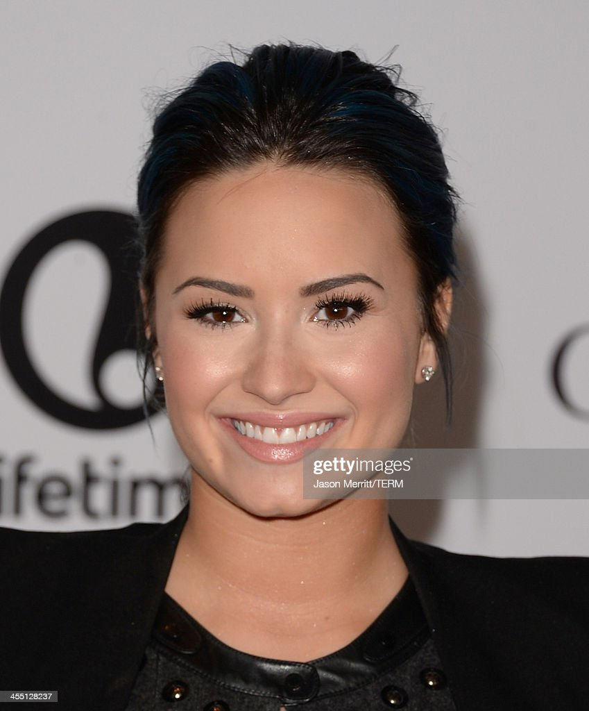 Singer/songwriter <a gi-track='captionPersonalityLinkClicked' href=/galleries/search?phrase=Demi+Lovato&family=editorial&specificpeople=4897002 ng-click='$event.stopPropagation()'>Demi Lovato</a> arrives at The Hollywood Reporter's 22nd Annual Women In Entertainment Breakfast at Beverly Hills Hotel on December 11, 2013 in Beverly Hills, California.