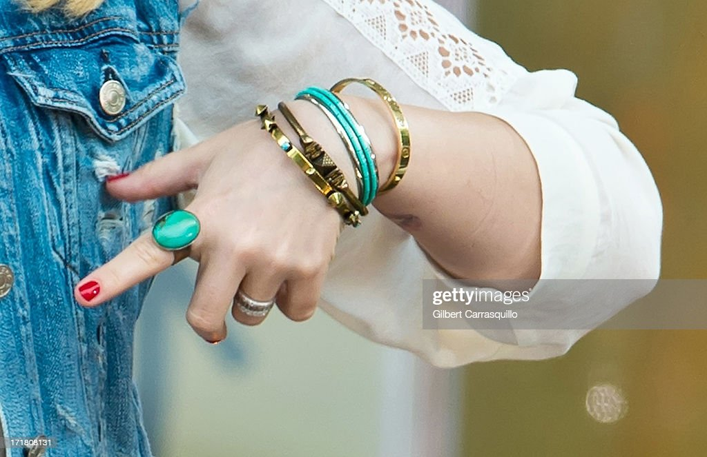 Singer-songwriter Demi Lavato (jewelry detail) performs during ABC's 'Good Morning America' at Rumsey Playfield on June 28, 2013 in New York City.