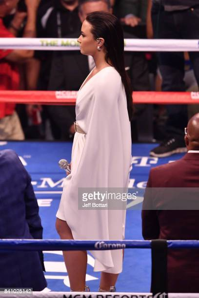 Singer/songwriter Demi Lovato performs the American national anthem prior to the super welterweight boxing match between Floyd Mayweather Jr and...