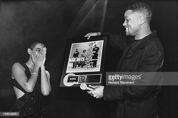 Singersongwriter Diana King receives a gold disc from actor Will Smith at an afterparty for the film 'Bad Boys' 1995 She contributed the song 'Shy...