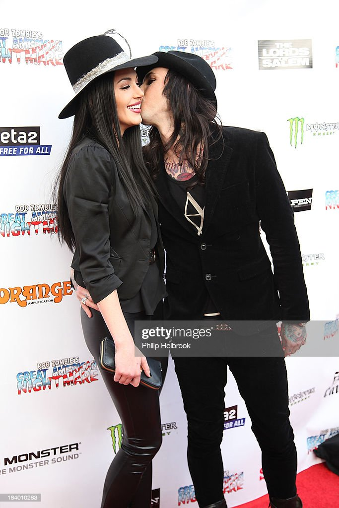 Singer/Songwriter Dorothy Martin and Musician Michael Orlando arrive at the VIP opening night party at Rob Zombie's Great American Nightmare held at the Fairplex on October 10, 2013 in Pomona, California.