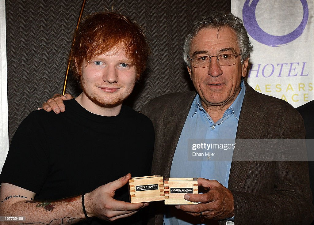 Singer/songwriter Ed Sheeran (L) and actor Robert De Niro attend a sake ceremony during the grand opening celebration of the world's first Nobu Hotel Restaurant and Lounge Caesars Palace on April 28, 2013 in Las Vegas, Nevada.