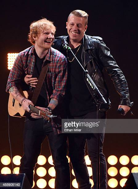 Singer/songwriter Ed Sheeran and rapper Macklemore perform during the 2014 iHeartRadio Music Festival at the MGM Grand Garden Arena on September 20...