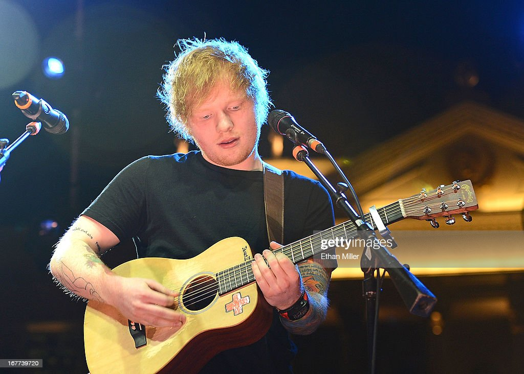 Singer/songwriter <a gi-track='captionPersonalityLinkClicked' href=/galleries/search?phrase=Ed+Sheeran&family=editorial&specificpeople=7604356 ng-click='$event.stopPropagation()'>Ed Sheeran</a> performs during the grand opening celebration of the world's first Nobu Hotel Restaurant and Lounge Caesars Palace on April 28, 2013 in Las Vegas, Nevada.