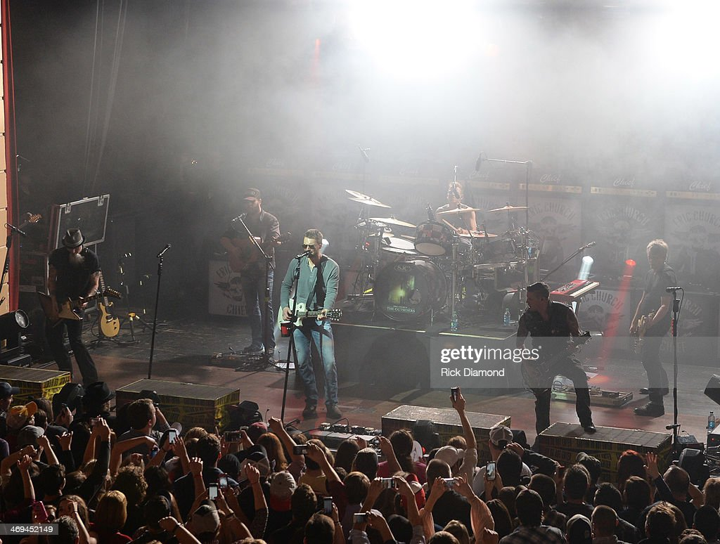 Singer/Songwriter <a gi-track='captionPersonalityLinkClicked' href=/galleries/search?phrase=Eric+Church&family=editorial&specificpeople=619568 ng-click='$event.stopPropagation()'>Eric Church</a> (center) and his band Celebrate the release of his new album 'The Outsiders' with The Outsiders Live Tour at the Buckhead Theatre on February 14, 2014 in Atlanta, Georgia.