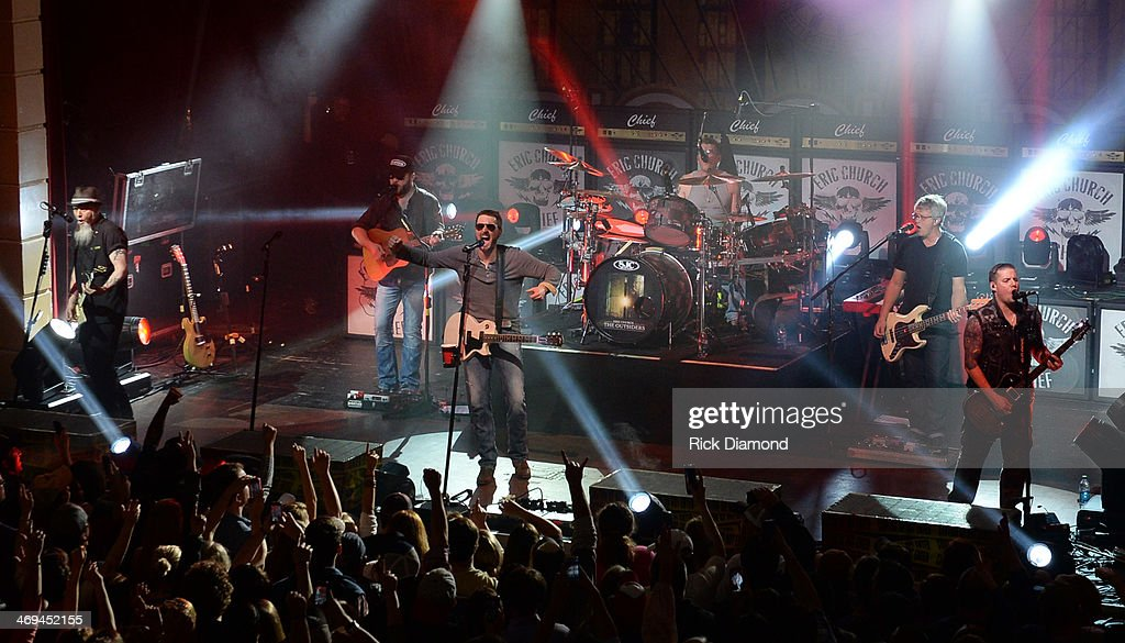 Singer/Songwriter Eric Church (center) and his band Celebrate the release of his new album 'The Outsiders' with The Outsiders Live Tour at the Buckhead Theatre on February 14, 2014 in Atlanta, Georgia.