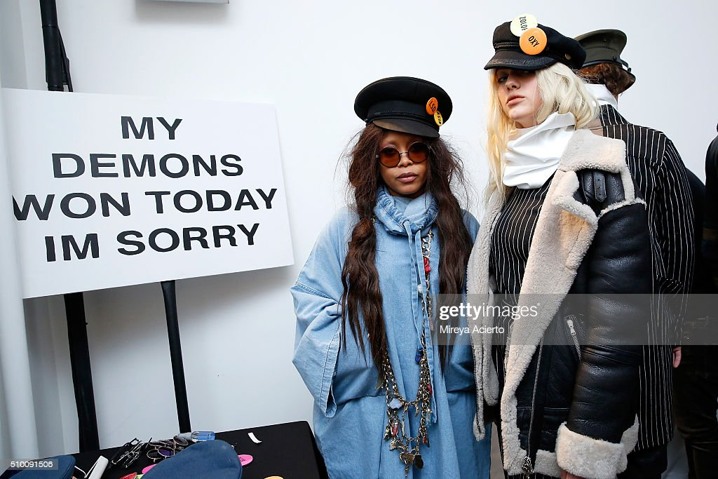 Singersongwriter Erykah Badu and a model prepare backstage at the Pyer Moss Fall 2016 fashion show during MADE Fashion Week at Milk Studios on...