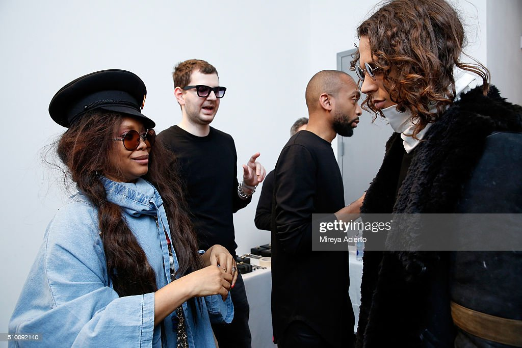 Singer-songwriter <a gi-track='captionPersonalityLinkClicked' href=/galleries/search?phrase=Erykah+Badu&family=editorial&specificpeople=224744 ng-click='$event.stopPropagation()'>Erykah Badu</a> prepares a model backstage at the Pyer Moss Fall 2016 fashion show during MADE Fashion Week at Milk Studios on February 13, 2016 in New York City.