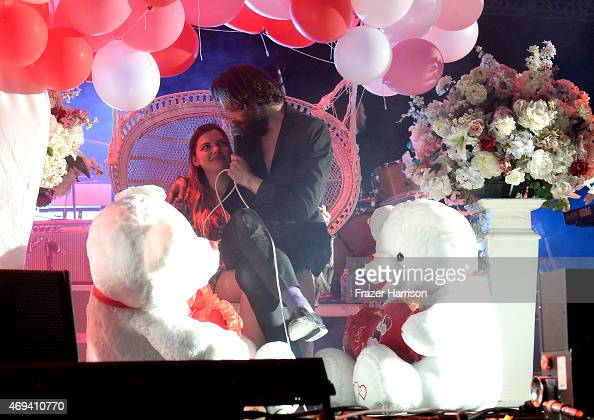 Singersongwriter Father John Misty sings to a fan onstage during day 2 of the 2015 Coachella Valley Music Arts Festival at the Empire Polo Club on...